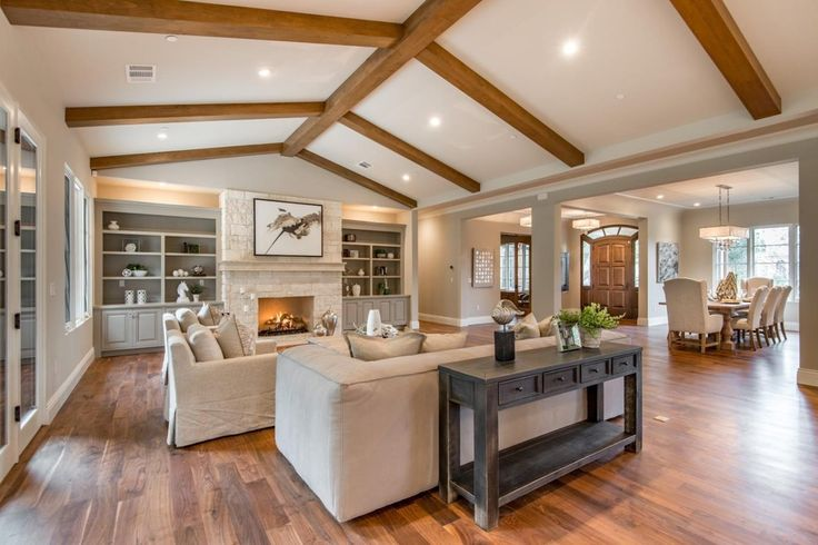 traditional living room  columns exposed beam