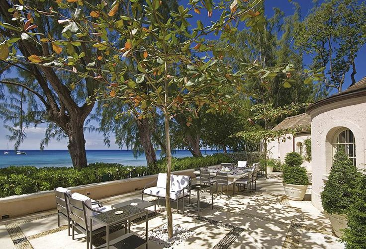 Pink Cottage, St James - Sleeps up to 8. Perfectly positioned on a beachfront corner of the exclusive Heron Bay estate, this luxury villa in St. James is a chic retreat in sumptuous gardens – and a favoured haunt of some very famous people.