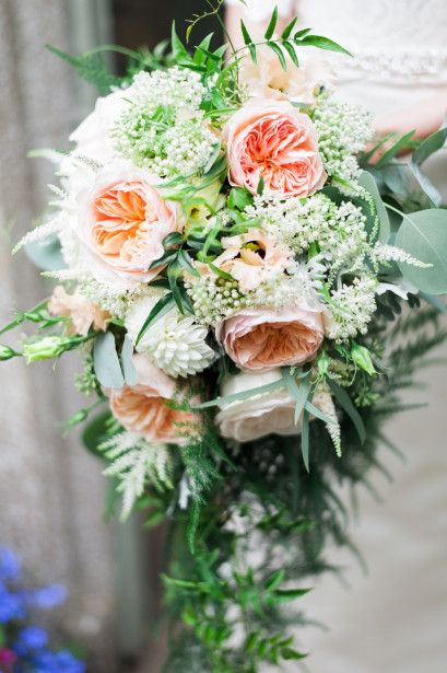 David Austin 'Juliet' rose, ivory dahlias, peach lisianthus with astilbe and astrantia, eucalyptus, asparagus fern and jasmine