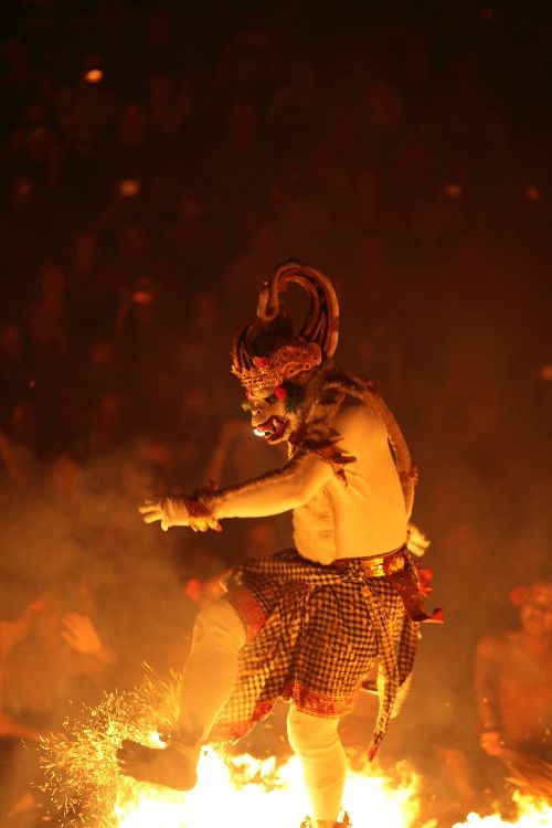 Bali. Hanoman the white monkey puts out the fire in the Kecak and Fire dance at Uluwatu Temple. Photo Paul Kennedy