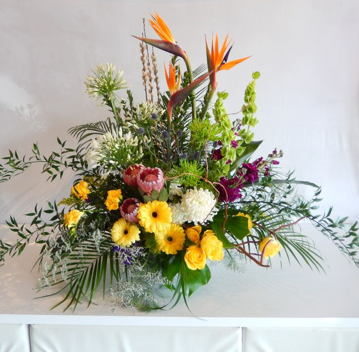 A beautiful , very colourful lobby arrangement for a local Law firm from Dizennio Floral Boutique-Vaughan. A truly tropical atmosphere is created by the Bird of Paradise, white Agapanthus and grouping of gorgeous Protea !