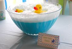 Baby Shower-Ducky Punch - Blue Hawiian Punch, Sprite, & Vanilla Ice Cream - added the chilled punch to the punch bowl and topped it with scoops of ice cream. Then I poured the Sprite on top and that's what created the bubbles. Finally, we topped it off with some clean rubber ducky's that we washed well in hot water. I did all of this at the last minute, because I wanted the bubbles to be there when the guests arrived.