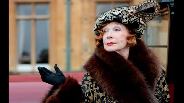 """For those hoping to see Martha and The Dowager Countess' feuds explode in a Dynasty-esque fountain fight, you will be sorely disappointed. But those looking for verbal fireworks are in luck! """"The gunfight at the OK Corral does not happen between Maggie [Smith] and me,"""" MacLaine adds. """"We do a little sparring, we have our moments but it's more sophisticated than that."""": Downtonabbey, Maggie Smith, Shirley Maclain, Downtown Abbey, Downton Abby, Martha Levinson, Abbey Seasons, Downton Abbey, Marthalevinson"""
