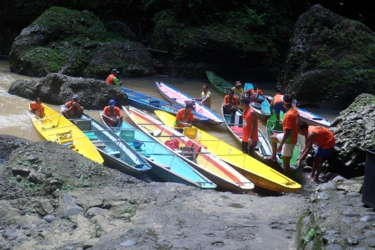 Experience an exciting canoe ride upriver as you 'shoot the rapids' in a dugout canoe