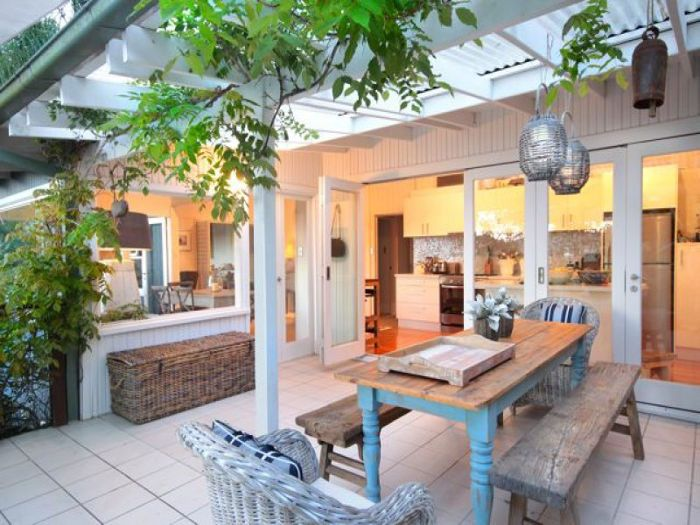 love how this covered patio manages to be light and bright