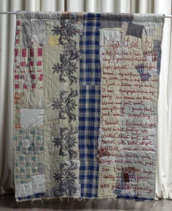 Quilt, with embroidered writing.