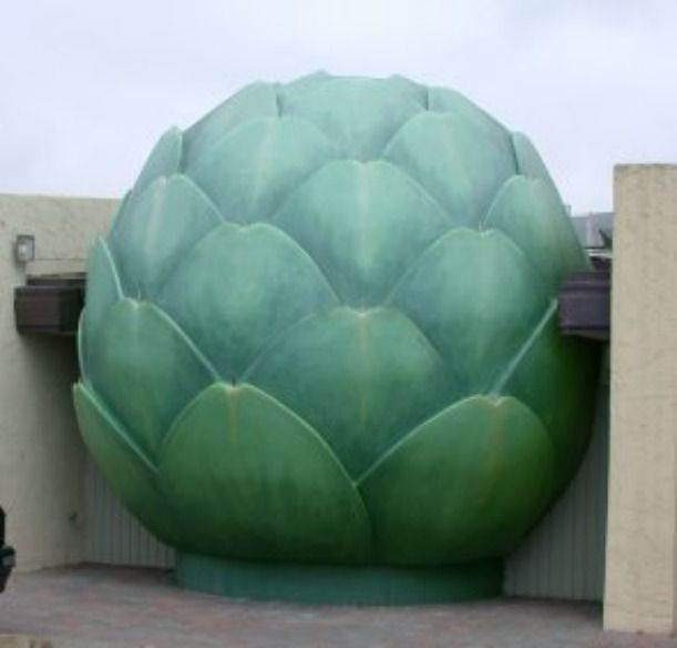 """Castroville, California, is the self-proclaimed """"Artichoke Center of the World"""" and the 20-foot tall artichoke made of rebar and concrete built in 1963 by Ray Bei, founder of Ray Bei's Giant Artichoke Restaurant and Fruit Stand, is a stunning reminder of the region's main crop."""