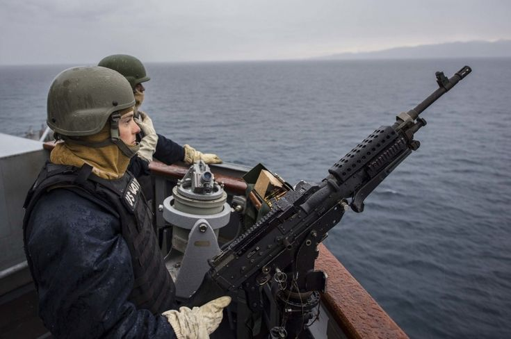 Seaman mans an M240B machine gun on the bridge wing of the Arleigh Burke-class guided-missile destroyer USS Carney (DDG 64) while underway in the Aegean Sea.
