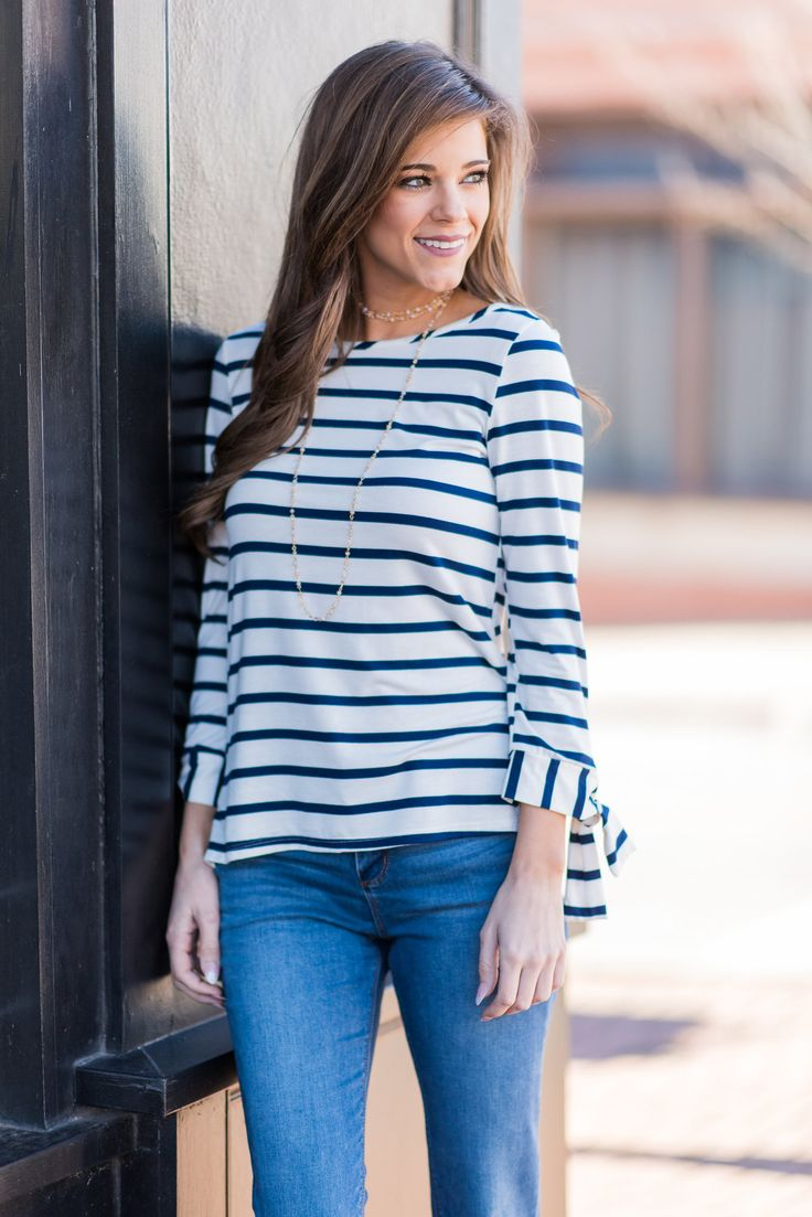 This will totally make you happy! It's wonderfully soft and stretchy fabric and classic cut make it so comfy! We love those nautical colors too! They make adding a pop of color so easy and fun! This top also features adorable little ties on the sleeves which we think will surely make you happy too!  Material has generous amount of stretch.  Miranda is wearing the small.