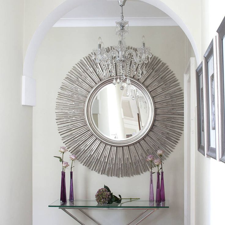 Decoration Plain White Wall Paint Color Background With Crystal Chandelier Also Decorative Round Sunburst Mirror