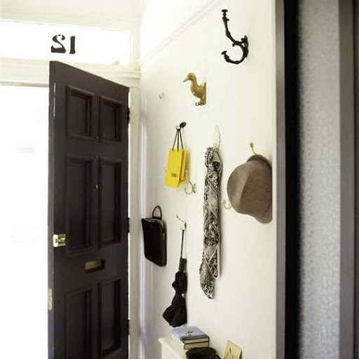 Small entryway hanging solutions. Put a drop spot shelf underneath . Love the mismatched hooks