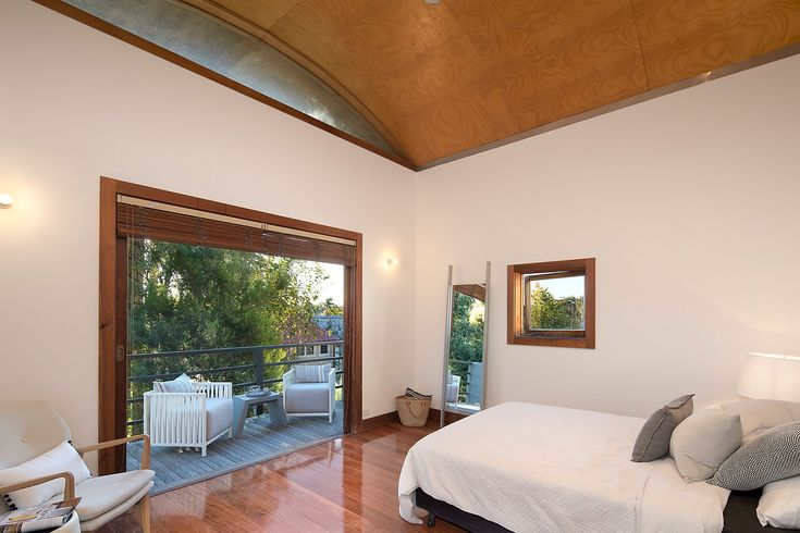 Architecturally redesigned - main bedroom opens to wide balcony #VirginiaKerridge #architect #renovation #masterbedroom #interiordesign #design