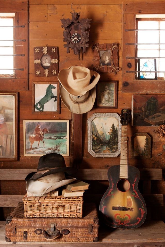 A vignette grouped around a theme, like the country-western one shown above, can elevate the aesthetic of thrift shop finds.