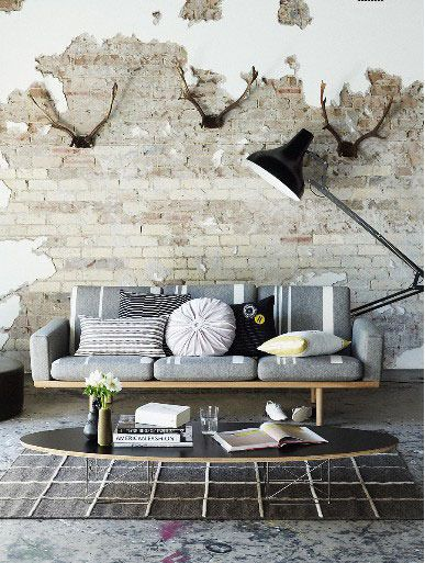 """""""unfinished"""" wall with plaster over brick.  a) I love this blog (apartment therapy)  and b) I'm really getting interested in this idea"""