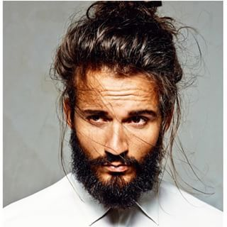 This brooding beefcake. | 23 Beard And Man Bun Combinations That Will Awaken You Sexually