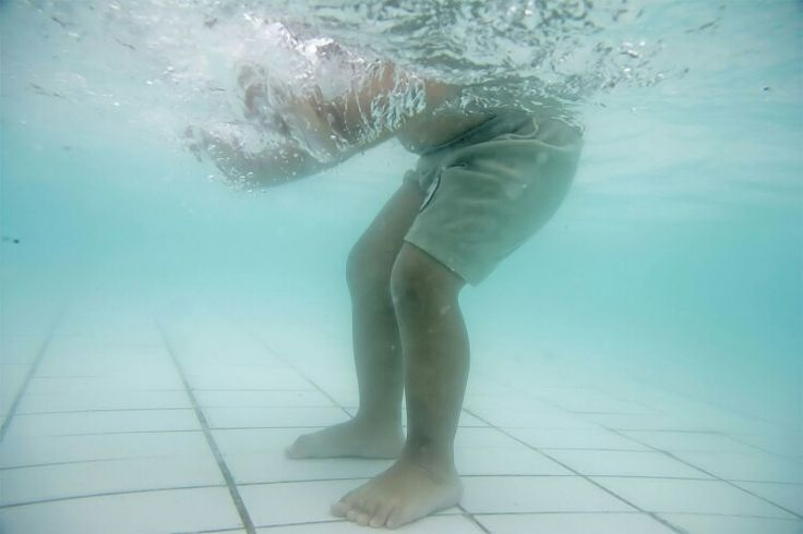 My son feet. Because he is not yet can swim nor dive. We can only take pictures of this part of his body. LOL
