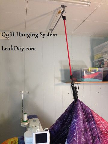 Check out Leah Day's quilt hanging system that makes quilting larger quilts much easier: http://leahday.com/pages/sewing-machine-review-juki-2200-sit-down-longarm