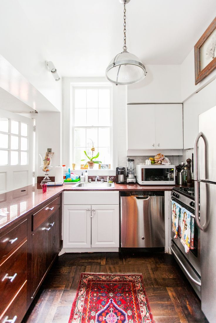 Beautiful mix of stainless, white, and wood in this kitchen