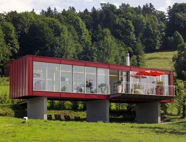 red shipping container home made of glass