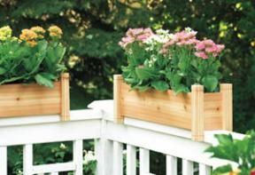 Cedar #planter boxes placed on the railings of your wood #deck make a simple and elegant way to bring life and #color to your outdoor space.