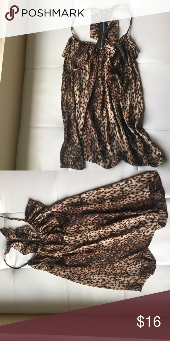 Cheetah print shirt Silky cheetah print shirt. Razor back kind of back with a zipper. Slightly longer in the back. Very pretty shirt. Can dress up with a skirt and tuck it in or dress down with leggings and boots. My favorite! Tops Blouses