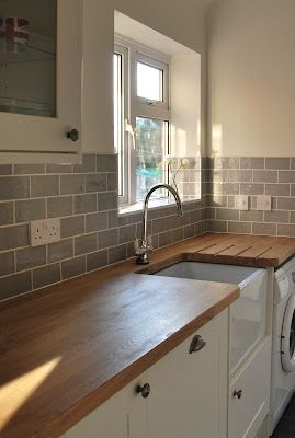 belfast sink, grey subway tiles. Link was bad, but picture tells it all.