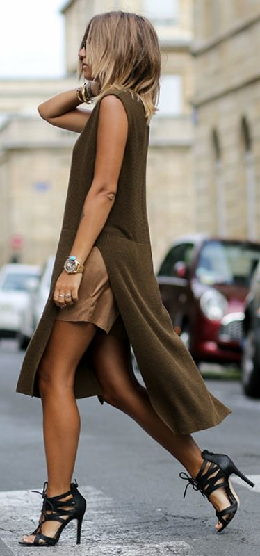 High slit layers are definitely in - why not wear one over a tan mini skirt with black heels. Via Camille Callen   Dress: Zara, Sirt: Jennyfer, Shoes: Jennyfer
