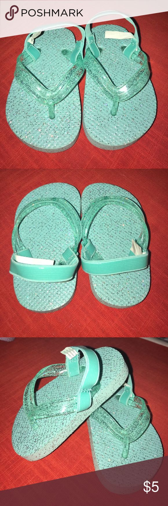 Teal Little Girls Sandals Teal sandals. Easy slip on. Strap goes around the back of the ankle. Never worn. Size 4/5 Shoes Sandals & Flip Flops