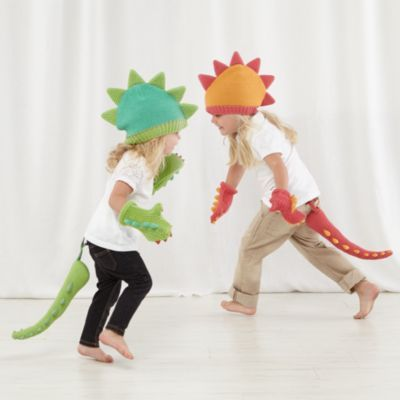 If you see a colorful dinosaur roaming around the playroom, don't be alarmed. It's probably just someone wearing one of our exclusive knit dress-up sets featuring a cap, mittens and tail. If you see a scaly, giant dinosaur roaming the playroom, chances are it's real.