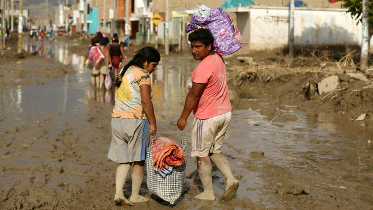 In Peru, the death toll from the country's worst flooding in more than 30 years is rising. At least 90 people have now died. The flooding caused by torrential downpours linked to climate change has also destroyed tens of thousands of houses and displaced more than 100,000 people. The floods have also destroyed thousands of roads, bridges and highways across Peru, paralyzing commerce and making it harder to transport aid to affected regions.