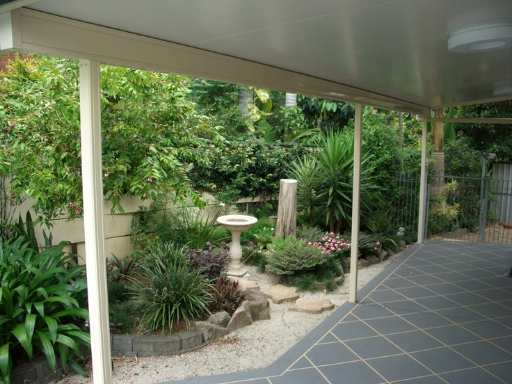 Insulated patio with a garden view