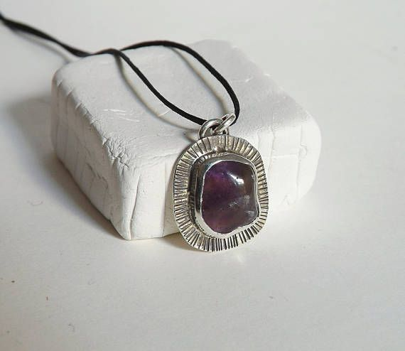 Check out this item in my Etsy shop https://www.etsy.com/listing/577721860/hammered-rough-amethyst-necklace