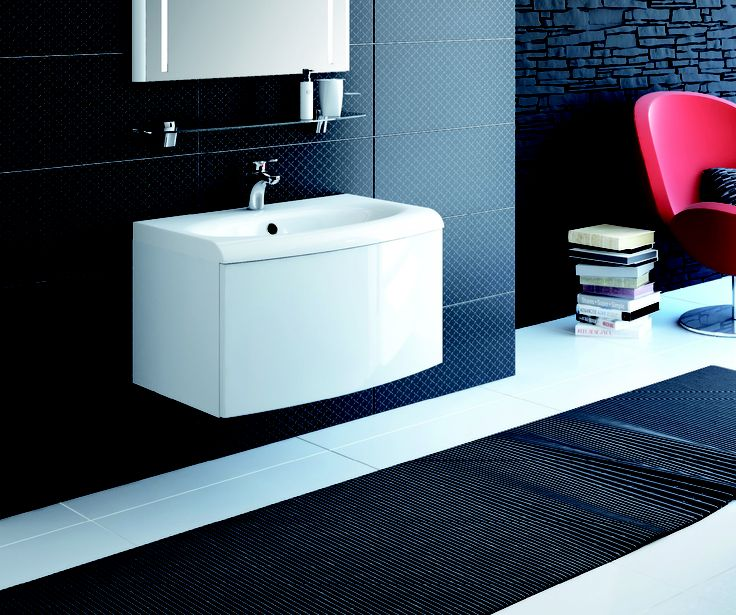 Evolution Concept A unique look for unique bathrooms - A striking bath complemented by a washbasin and bathroom furniturein matching design.