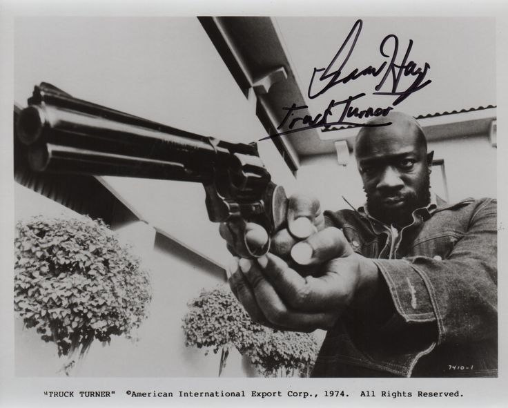 HAYES ISAAC: (1942-2008) American Singer-Songwriter, and Actor. Signed 10 x 8 photograph, the image depicting Hayes standing in half-length pose pointing a large hand gun, in a scene taken from the film Truck Turner, 1974. Signed by Hayes in bold black ink to a clear area of the image, adding 'Truck Turner' beneath his signature.