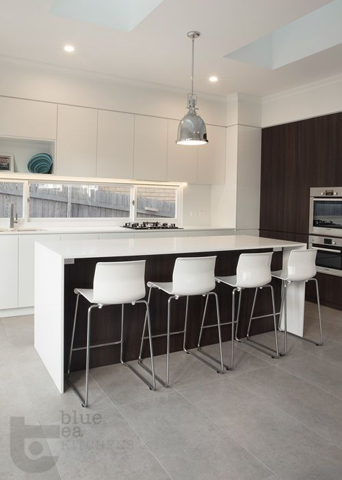 white cabinets, timber feature doors and concrete tiles   Custom Kitchens Sydney   Blue Tea