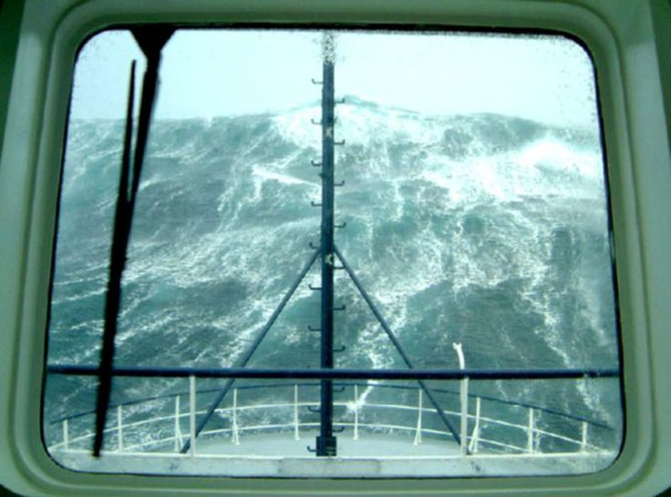Rogue waves are random huge waves that occur in deep ocean, not on the coast.