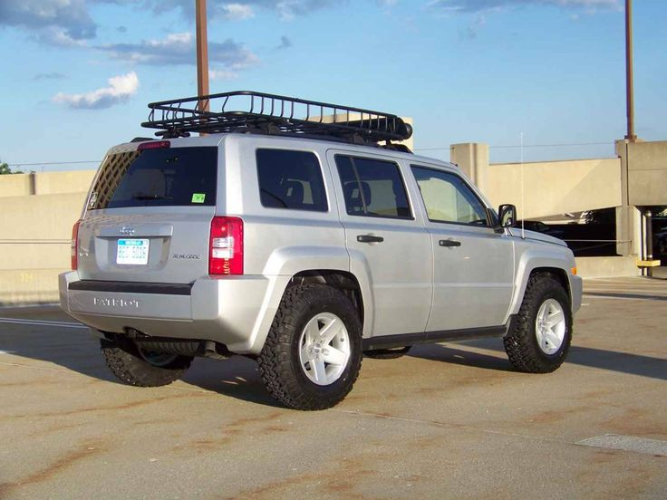 Trail rated Jeep Patriot with lift kit and TJ rims