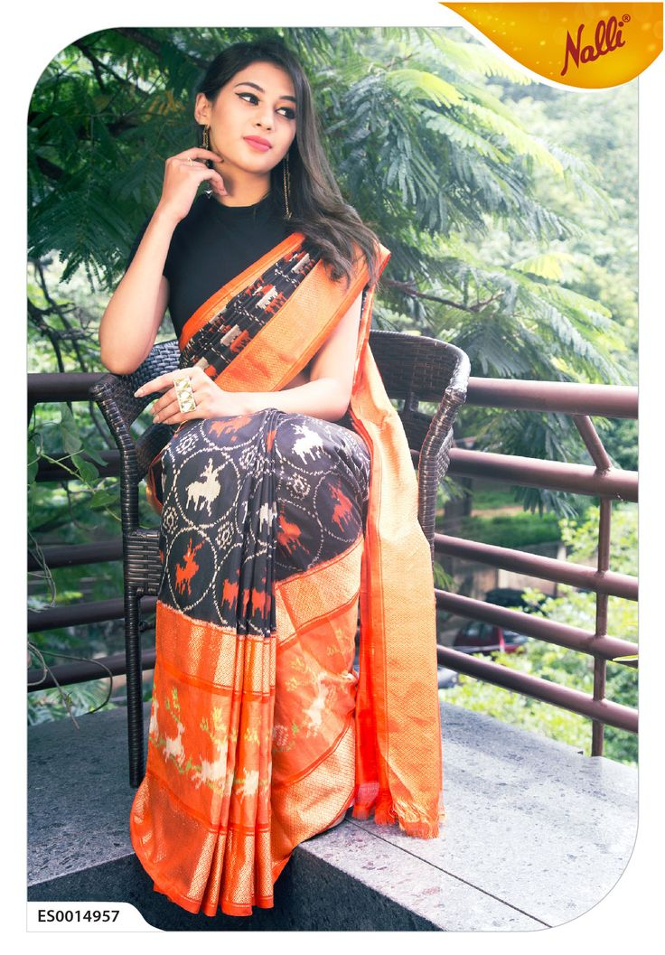 FOR THE LOVE OF BLACK. Here's a classic black pure Ikat Silk Saree. Rare and traditional Ikat designs of reindeer on body and border are not to be missed!