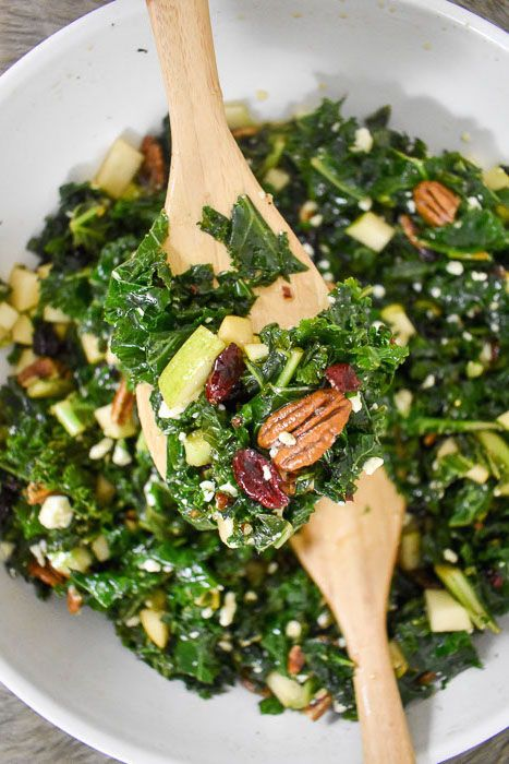 """Although """"addictive"""" and """"kale"""" don't typically go hand in hand, this addictive massaged kale salad will change your mind with one bite! It's tender, full of flavor, and made with nuts, blue cheese, and seasonal fruit. Recipe by Dash of Jazz via @dashofjazzblog"""