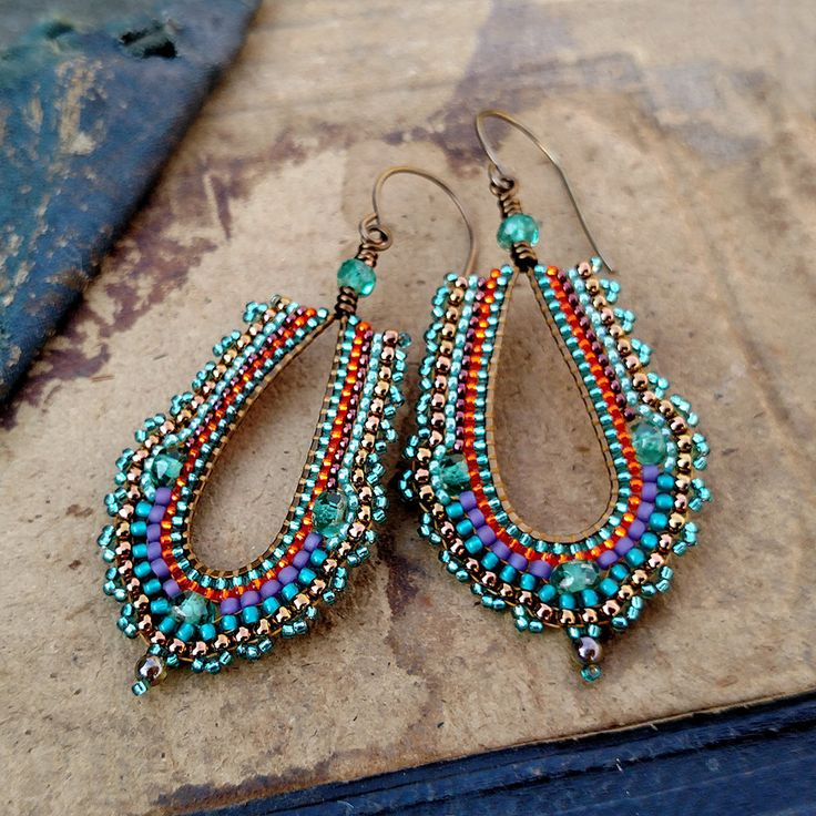 Peacock Hoop Earrings, Purple Seed Bead Hoop Earrings, Long Teardrop Teal and Aqua Earring by windyriver on Etsy https://www.etsy.com/ca/listing/449552444/peacock-hoop-earrings-purple-seed-bead