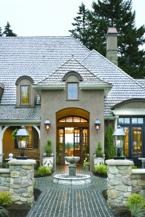 Just look at the roof overhangs, the different mouldings on each side of the front door. LOVE this entry. It could be for backyard too... great looking roof, stone and stucco colors, front door... Idea for landscaping in front of Fl room... Light on either side if entry... grand entry... Front door!... Front entry... Rock entry... Entry - see though... Front courtyard... Fountain in front... The front walk way... entry lights courtyard... Front pots... Front house... Fountain @ the front…
