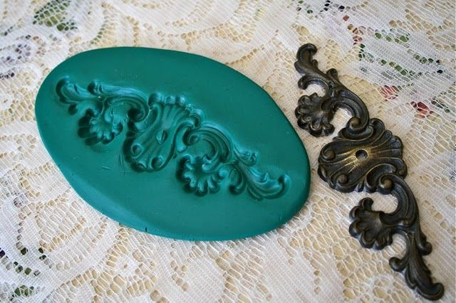 How to make molds for your own plaster ornamental appliques for furniture, wood projects, etc. - easy tutorial here: http://thepolkadotcloset.blogspot.com/2011/06/how-to-make-ornamental-plaster.html