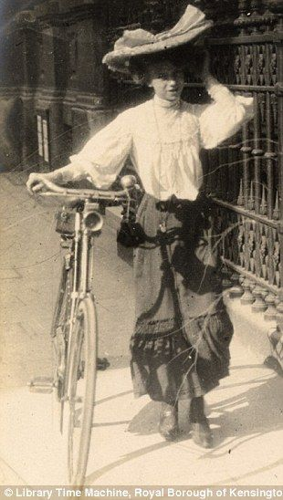 A female cyclist fiddles with her hat in Kensington on September 8th 1906..wonderful images by the late amateur photographer Edward Linley Sambourne,  Read more: http://www.dailymail.co.uk/femail/article-2173872/Edwardian-street-style-Astonishing-amateur-images-capture-fashion-women-London-Paris-century-ago.html#ixzz2bx4QVmxi Follow us: @MailOnline on Twitter   DailyMail on Facebook