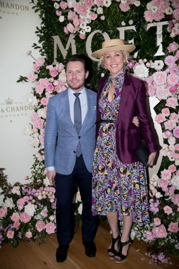 Nick Smith and Kerrie McCallum at the Moet & Chandon race day at the Royal Randwick racecourse.