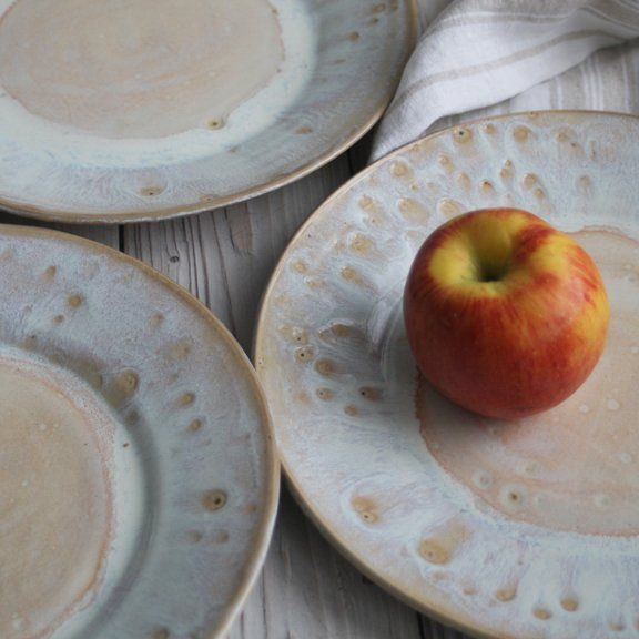 These 4 super rustic dinner plates were hand thrown and trimmed on my potter's wheel using a white stoneware clay. They were bisque fired and glazed with a beautiful white glaze with rustic spe...