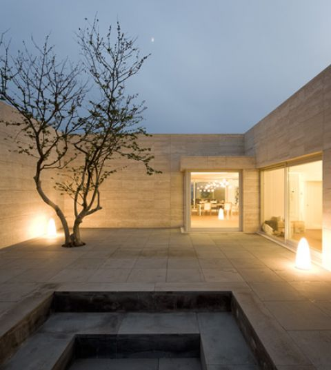 Traverine clad courtyard inside the Jeju House in South Korea by Portugese architects Alvaro Siza.