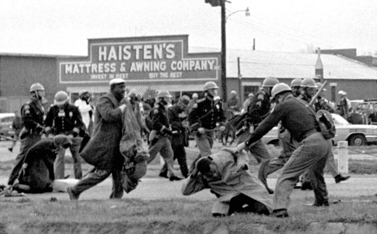 State troopers swing billy clubs to break up a civil rights voting march in Selma, Alabama, on March 7, 1965. John Lewis, the chairman of the Student Nonviolent Coordinating Committee (in the foreground) is being beaten by state troopers. Lewis would go on to become a U.S. congressman, elected as the representative for Georgia