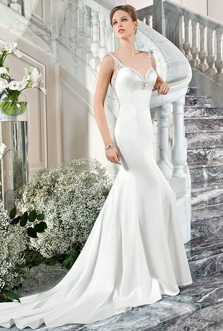 Brides: Demetrios - Couture. This sophisticated, luxe satin, form fitting gown with a jeweled sweetheart neckline features sheer, beaded straps transitioning into a magnificent illusion back embellished with crystal beaded embroidery and button closure.
