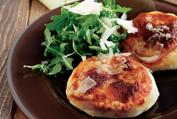 Mini Pizzas topped with Parma ham, Parmesan Cheese with Arugula