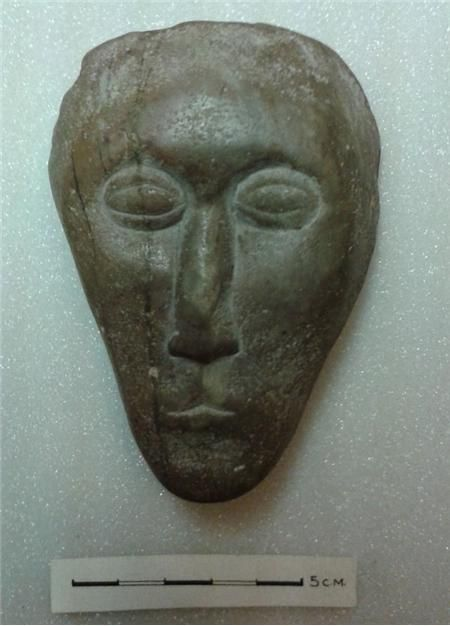 A possible iron age anthropomorphic stone carving from